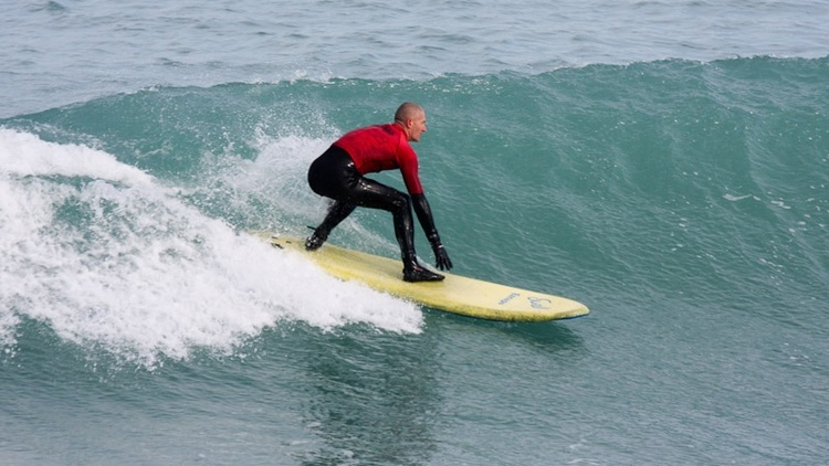 mike young riding a swelly on a surf lesson in newquay